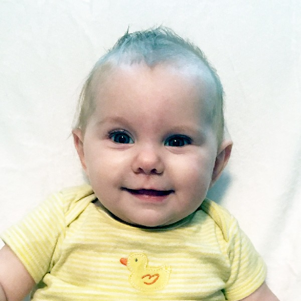 Image of a baby girl smiling.