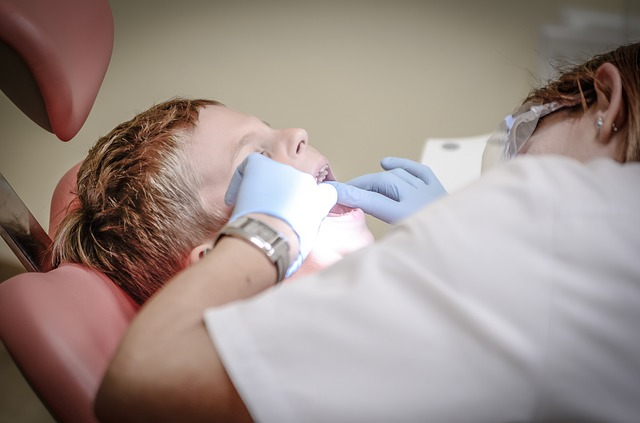 Image of a young child getting their teeth looked at.