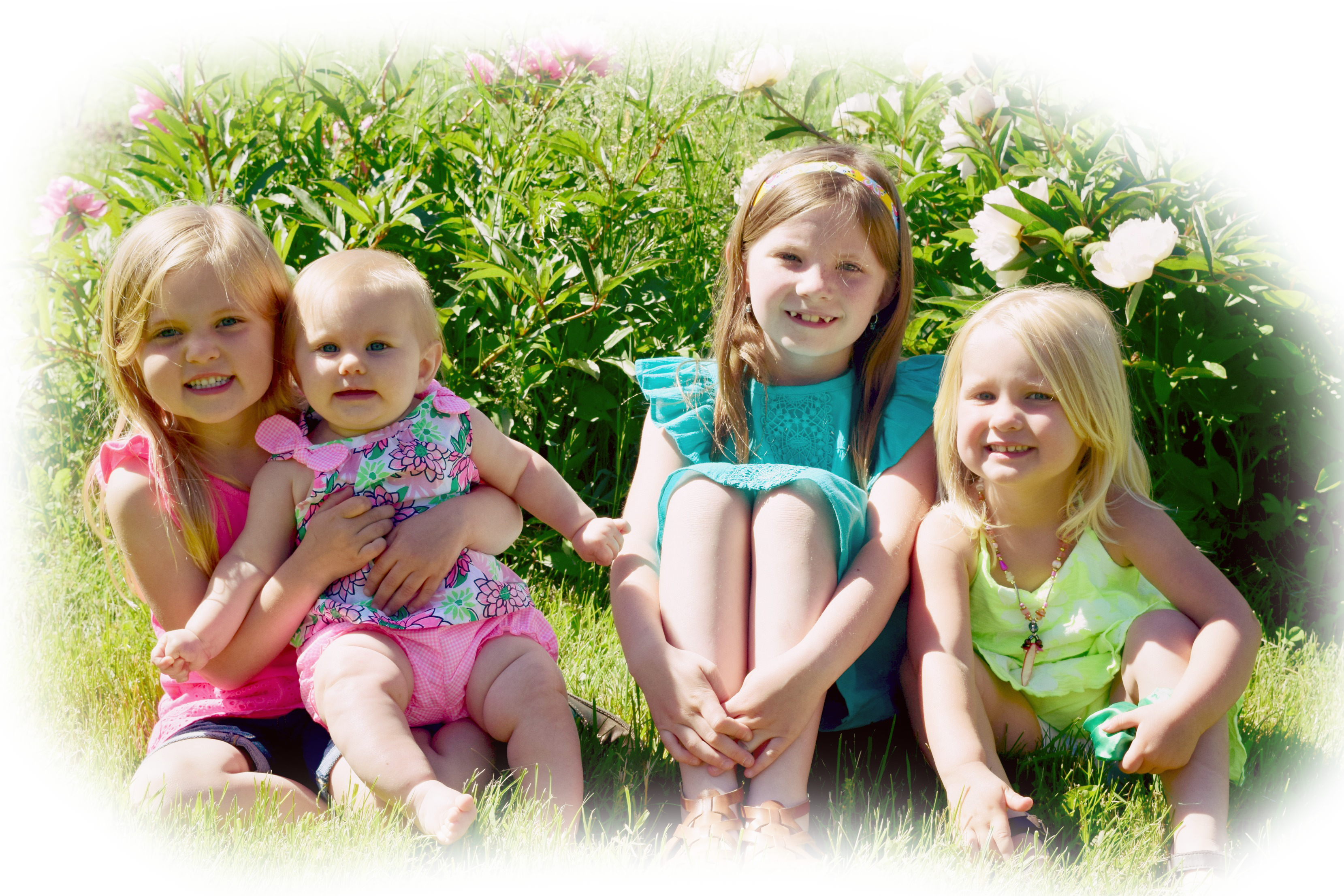 This is an image of four young girls smiling.